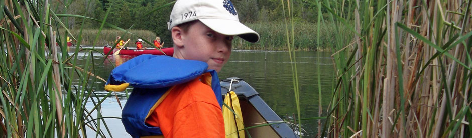 Boy learning to canoe