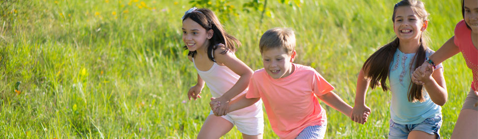 happy kids running in a field
