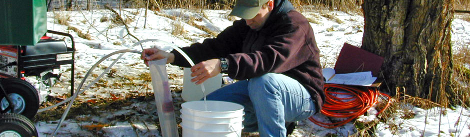 Staff using equipment to take groundwater samples