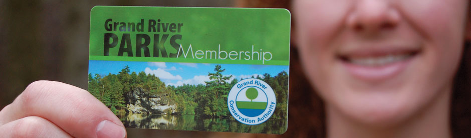 Woman holding a Grand River Parks membership card