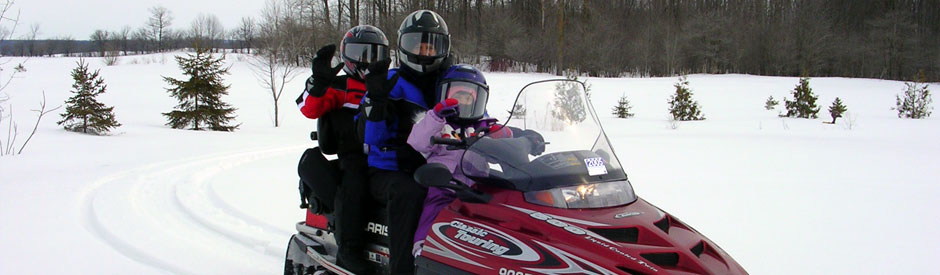 Family on snowmobile at Conestogo Lake Park