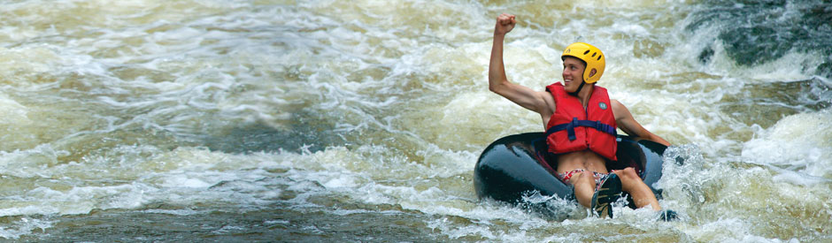 Man tubing in rushing waters of Elora Gorge