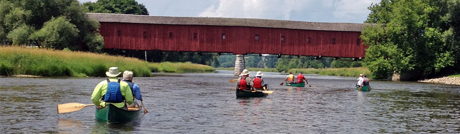 Canoeing the river with West Montrose bridge in background