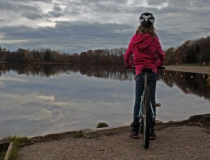 girl on bike looking at water