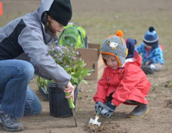 Syngenta employees and families helping plant wildflowers